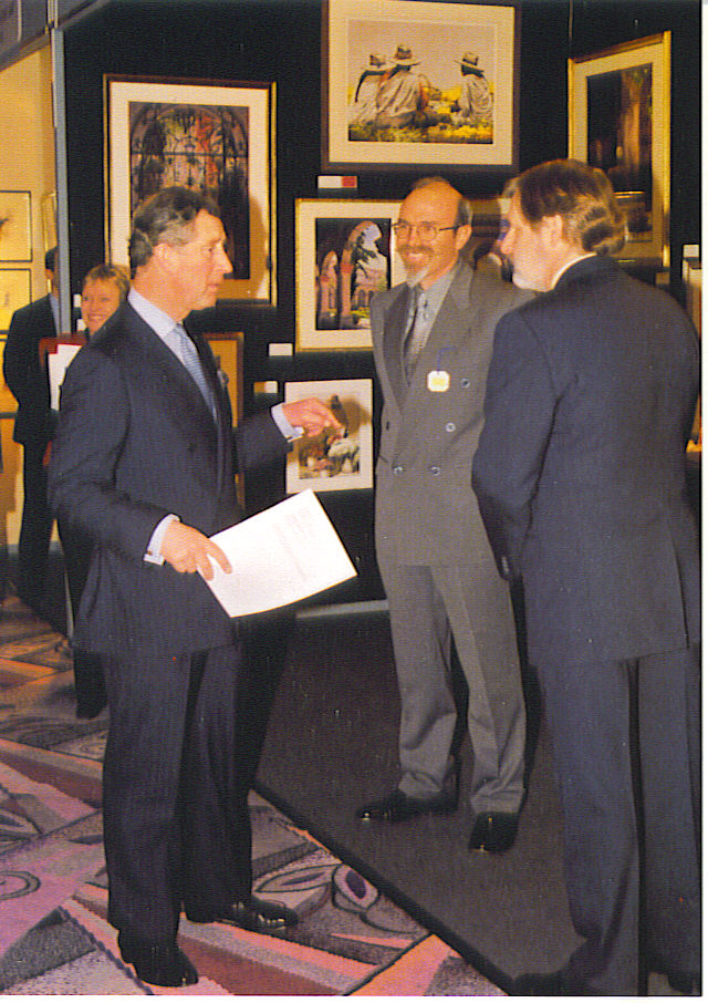 Raul Mercier (center) stands with Prince Charles dur- ing a gallery opening in England. His next art stop will be on Main Street in Zionsville. (Submitted photo)