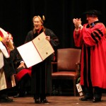 Actress Meryl Streep proudly shows her honorary diploma to the audience on April 16. Indiana University Grand Marshall Mikel G. Tiller, left, IU President Michael  McRobbie, right, look on. (Staff photo by Tonya Burton)