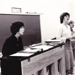 Carmel High School Choral Director Ann Conrad, left, plays the piano as she instructs students in this photo from 35 years ago. (Submitted photo)