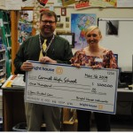 Carmel High School received $1,000 towards video equipment. CHS film and production teacher Jim Peterson accepted the award. (Submitted photo)