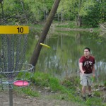 Hole 10 at Hazel Landing Disc Golf Course is incredibly challenging because the fairway is adjacent to the White River with only a few old sycamore trees to prevent expensive discs from floating into the permanent water hazard. Pictured, Will Judson of Lafayette tosses a putter into the goal on the treacherous hole. (Staff photo)