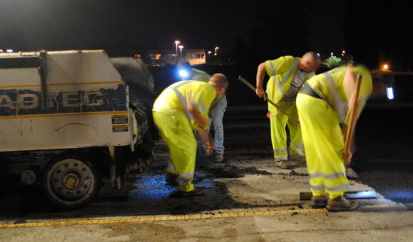 City street department crews are working to repave portions of Pennsylvania Street in Carmel. (Staff photo)