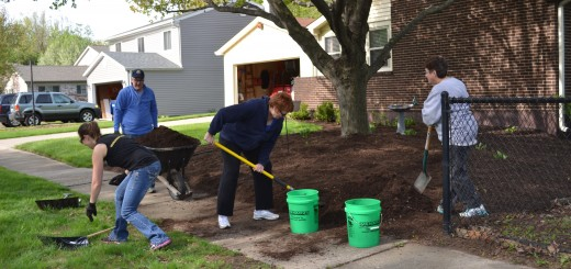"""Volunteers work on a yard in Sunblest Countryview as part of a """"Keep Fishers Beautiful"""" neighborhood blitz. (Photo by Ann Craig-Cinnamon)"""