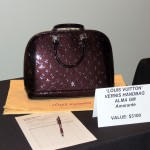 The most expensive handbag up for auction at the fundraising event was a Louis Vuitton valued at $3,100. (Staff photo by Tonya Burton)
