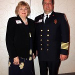 From left, Clay Township Board member Mary Eckard converses with