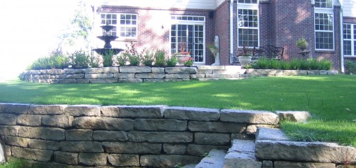 "A stone wall and steps on a driveway provide the ""triple threat"" elements to improve landscaping. (Submitted photo)"