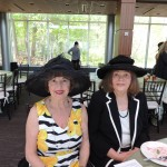 "Marilyn Goeke dons the hat she wears when playing Magdalena Holstein at James Whitcomb Riley historical functions.  Pat Noveroske wears a 1957 Schiaparelli during the ""Hats Off"" event May 8 at the IMA. (Staff photo by Tonya Burton)"
