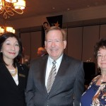 From left, Lilia Shiba from Japan, enjoys the company of Mayor Jim Brainard and Joyce Wozniak of the Sister Cities organization. (Staff photo by Tonya Burton)