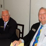Al Wozniak, left, and David Russell, members of Sister Cities organization, helped guests sign in for the event April 27 at Ritz Charles. (Staff photo by Tonya Burton)