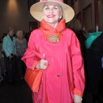 Jane Tuttle of Indianapolis dressed in a fuchsia ensemble with matching handbag. (Staff photo by Tonya Burton)