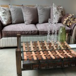 "Rogue Décor owner Adam Graef created this one-of-a-kind coffee table. The sofa is from the custom line ""New Dimensions"" and can be ordered in 300 different fabrics. (Staff photo by Tonya Burton)"