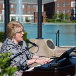 "Carmel resident Cindy Baney performed her song ""Honor"" during the recent Memorial Day ceremony. (Submitted photo by Beth Maier)"