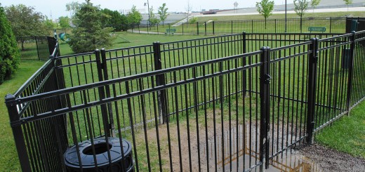 The dog park at Clay Terrace Mall recently installed a double gate to prevent dogs from escaping when others enter the park. (Staff photo)