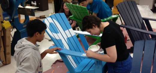 Members of the TechHOUNDS robotics club of Carmel High School work to paint the Adirondack chairs prior to the June 14 Gallery Walk. (Submitted photo)