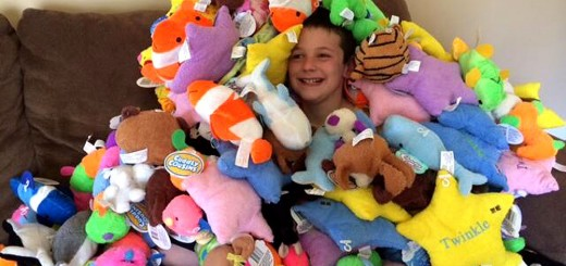 Nine-year-old Hudson Miles with the stuffed animals he donated to the Fishers Fire Department. (Submitted photo)