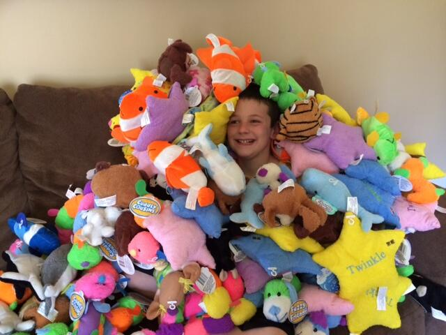 9-year-old Hudson Miles with the stuffed animals he donated to the Fishers Fire Department.