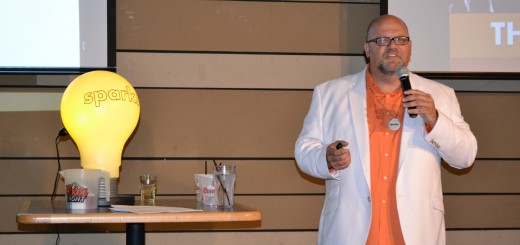 Chris Reed, founder of Sparks, introduces speakers to the networking crowd. (Photo by John Cinnamon)
