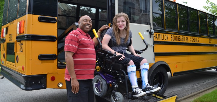 HSE bus driver John Miller with student Lizzie Ford, who he has transported to school every day for 12 years. During that time Ford and Miller have formed a spe- cial bond. (Photo by John Cinnamon)