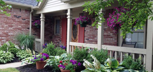 """Mark and Brenda Jordan of 14601 Beacon Blvd. won the """"Best Front Porch"""" category during last year's floral competition, which had purple as its dominant color. (Submitted photo)"""