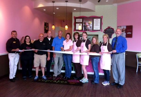 Art: GiGi's Cupcake, which opened and held its ribbon cutting on May 29, bakes its cupcakes fresh in the store daily a and has a different menu for each day of the week. (Photo by Anna Skinner)