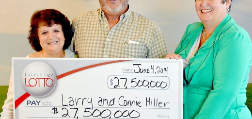 Hoosier Lottery Executive Director Sarah Taylor, right, presented Larry and Connie Miller with their $27.5 million jackpot winnings on June 4. (Submitted photo)