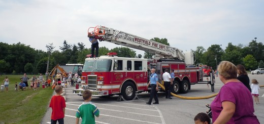 The Westfield Fire Dept. prepares for a water spraying demonstration with one of its ladder trucks at a previous Washington Town- ship Parks and Recreation Touch- a-Truck event. (Submitted photo)