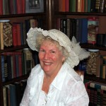 Peggy Rogers models a vintage white hat at the Carnegie Library 100th Anniversary Celebration. (Staff photo by Tonya Burton)