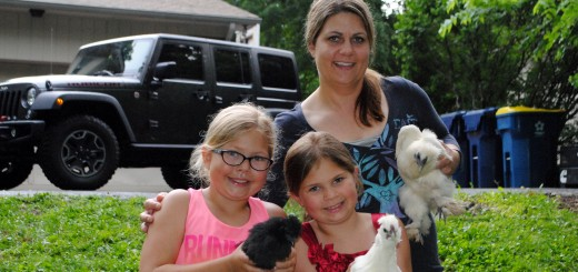 Tish York and her daughters Ellie, 9, left, and Maddi, 7, enjoy raising chickens in their back yard. (Staff photo)