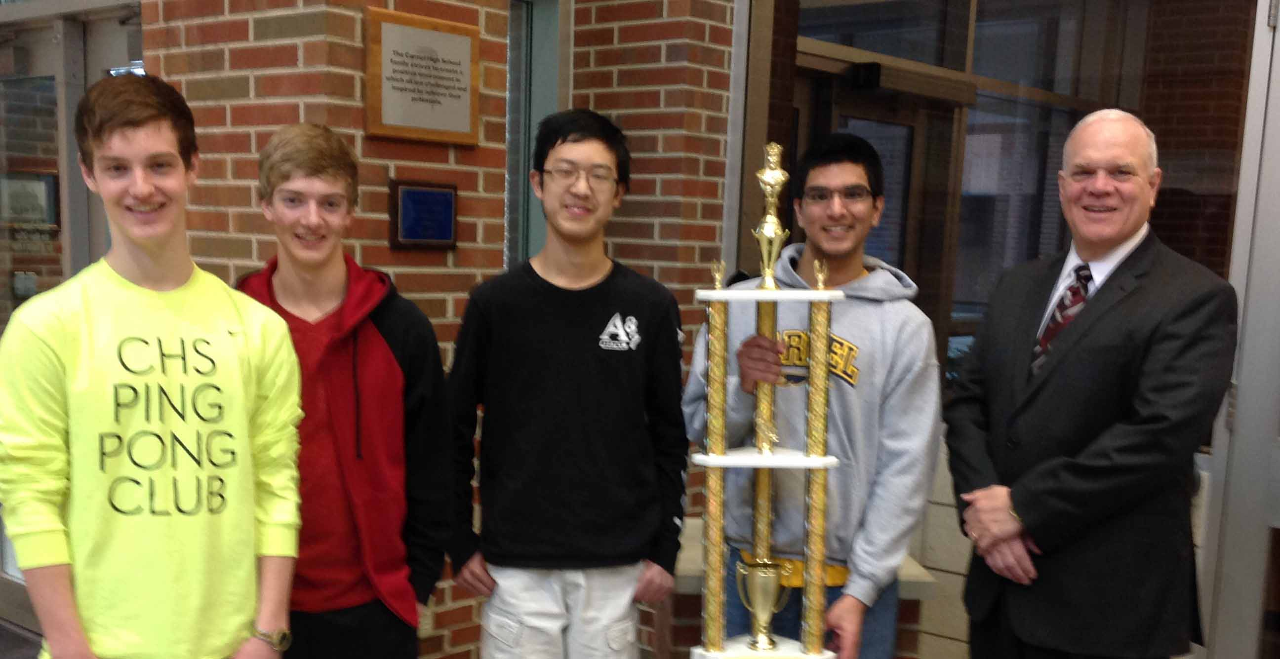 The Carmel High School chess team, from left, sophomore Joe Philleo, freshman Sam Philleo, Junior Kevin Mi and senior Sameer Manchanda with advisor Mr. Williams, won the Scholastic Chess of Indiana High School Team State Championship for the third year in a row. (Submitted photo)