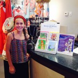 Liv Palmer, 11, at AH Collections with the Make-a-Wish Foundation cards that she designed