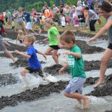 Kids of all ages had a great time wallowing in the mud on Mud Day July 12 at Cyntheanne South Park. (Photo by Ann Craig-Cinnamon)