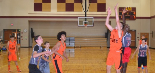Eighth-graders from England's Champions Academy (in orange) battle a Fishers team at Riverside Jr. High in a July 21 game. (Photo by John Cinnamon)