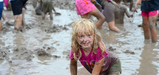 Zoe Milewski, daughter of Aaron and Jen Milewski of Westfield, gets down and dirty in the mud.