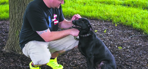 Iraq and Afghanistan wars veteran Greg Sexton of Noblesville with his black lab, Patton. (Submitted photo)