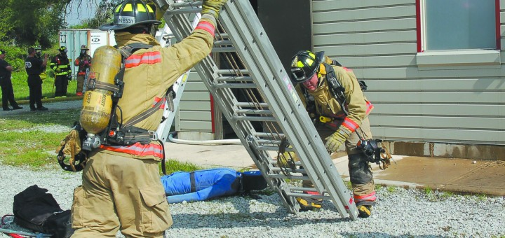 Fishers Fire Dept. recruits train during the training academy's fire curriculum portion of their class. There were 16 Fishers Fire Department recruits that graduated on June 25. (Photo by Chris Allen)
