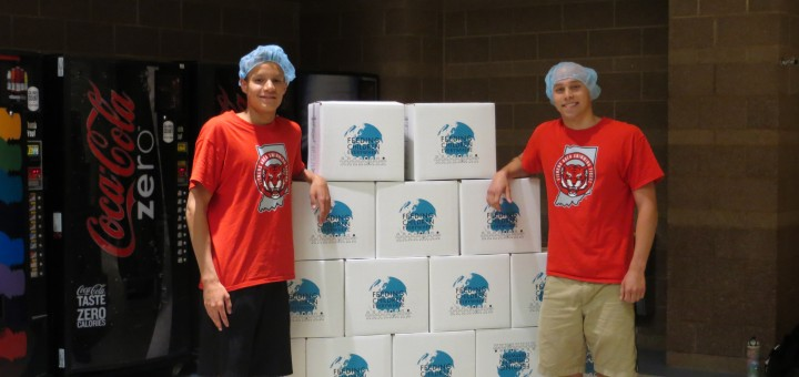 Brad Jacobs, (right) a senior at Fishers High School, with volunteer Glenn Brown created 12,000 meals for Fishers residents in need. (Submitted photo)