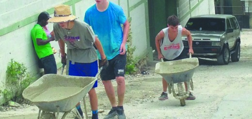 Jake McCrary, Jeffrey Lackey and Zach Radar fix the road in front of the orphanage. (Submitted photo)