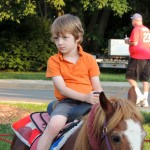 Benjamin Koerner rode a pony in the KidZone as his dad watched from
