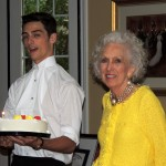 Lucas Miller presented the cake to Lorene on her 80th birthday. (Staff photo by Tonya Burton)