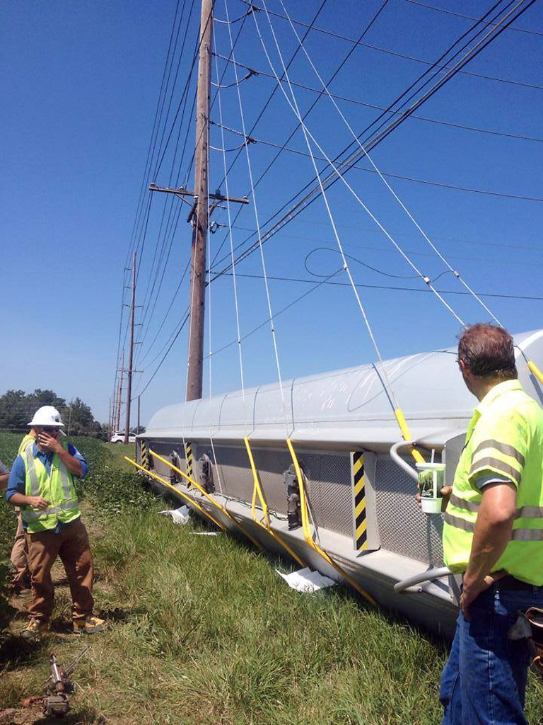 The overturned tanker trailer is braced as Duke Energy works to shut off the power so the semi can be moved on Aug. 14. Because of its location near power lines, it took crews eight hours to remove the diesel fuel tanker. (Submitted photo)