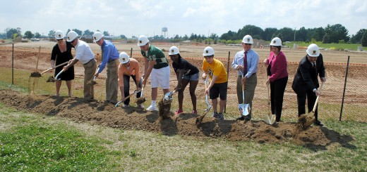 From left: Westfield High School Principal Dr. Stacy McGuire, Mayor Andy Cook, Westfield Washington Schools Supt. Dr. Mark Keen, WHS students Aaron Smith, Ryan Pape, Karen Hubbard and Johnny Crawford, Westfield City Council President Jim Ake, Riverview Health Chief Financial Officer Brenda Baker and Riverview Health COO Larry Christman break ground on the new community stadium Aug. 18. (Photo by Robert Herrington)