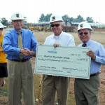 Westfield City Council President Jim Ake and Mayor Andy Cook present Westfield Washington Schools Supt. Dr. Mark Keen with a check for $2.5 million at the groundbreaking. The city is assisting with funding the project so the current stadium can be developed into taxable property. (Photo by Robert Herrington)