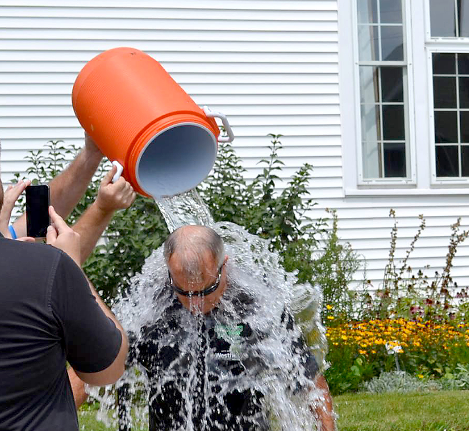 Mayor Andy Cook gets a bucket of ice cold water poured on him outside of Westfield's City Hall as he participates in the ALS Ice Bucket Challenge on Aug. 19. (Submitted photo)