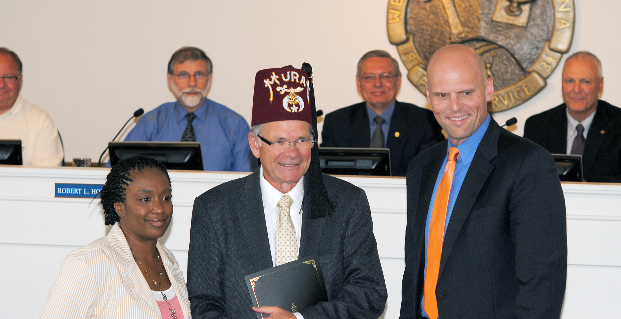 From left: Westfield White Castle General Manager Danielle Proctor, Shriner David Dore and Deputy Mayor Todd Burtron. Aug. 20 was declared Shriners Hospitals for Children Day and the Westfield fast-food location will be accepting donations to support sick children. (Photo by Robert Herrington)