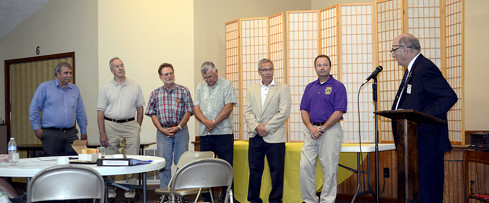 """From left: Board members Craig Cooley and Ron Perkins, """"Tail Twister"""" Larry Clarino, treasurer Joe Ed- wards, secretary Jeff Larrison and first vice president Dave Sobczak are inducted as Westfield officers by Jim Thompson, past district governor and member of the Carmel Lions Club."""