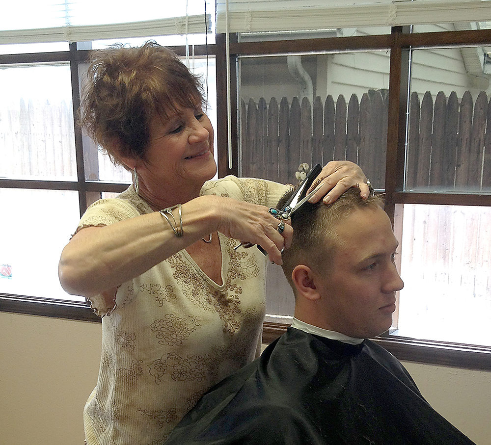 Pam Duff has been cutting hair for 35 years and now runs her own shop on Main Street. (Photo by Brianna Susnak)