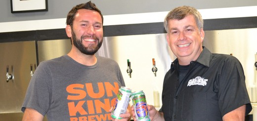 Clay Robinson (left) and Dave Colt, co- founders of Sun King Brewery, behind the bar at their downtown Indianapolis brew- ery. They are investing $10 million in a new facility in Fishers scheduled to open July 2015. (Photo by Ann Craig-Cinnamon)