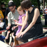 Kaufman sits with his wife and kids during a parade for the Indy 500 earlier this year. (Photo by Phil Taylor)