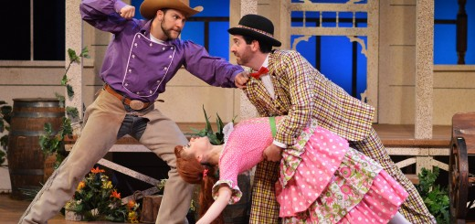 "A jealous Will Parker (Daniel S. Hines), left, prepares to throw a punch when he finds his sweetheart, Ado Annie (Timmy Hays) in the arms of the peddler Ali Hackem (Brian Sutow), who is giving her a ""Persian goodbye"" in Beef & Boards Dinner Theatre's production of Oklahoma! The high-spirited first collaboration of Rodgers & Hammerstein is now on stage through Oct. 5. Tickets range from $38.50 to $63.50 and include Chef Odell Ward's dinner buffet. For reservations, call 317.872.9664. For more information, including complete show schedule, visit beefandboards.com."