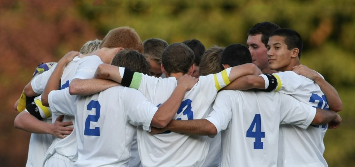 Carmel High School soccer players huddle together on the field. Out of thousands of students, only a few make the team. (Photo by Jerry Seiler)
